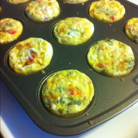 Doing this! Baby Breakfast Quiches: chop up and layer cooked bacon, a medley of fresh veggies, and shredded cheese. Whip up 6-8 eggs with milk and add 1tsp of flour. Pour mixture on top. Bake for 18 mins at 350 and you have a healthy on-the-go breakfast for the week!2