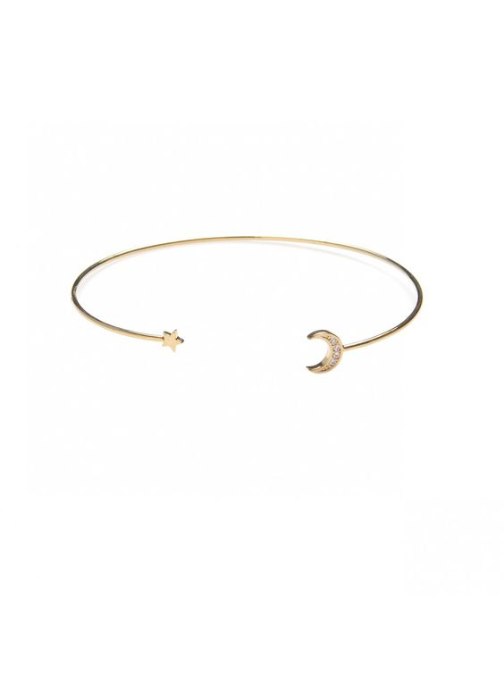A pave crescent moon and a delicate shooting star accent the ends of this fun
