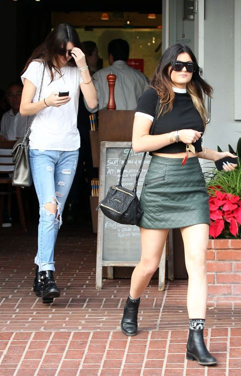 Jeans, tees, and black boots are the Jenners' wardrobe staples, but they never look boring. Kendall and Kylie make snoozy basics look ultra cool with unique details, like distressed denim, a black tee with white trim, printed socks peeking out of ankle boots, and a cool metallic bag.
