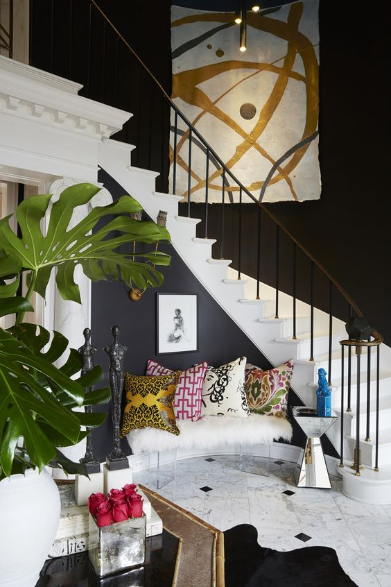 The pillows are a collection from different fabric houses Em admires. The large canvases on either staircase were commissioned works by California-based artist Allison Cosmos. Em saw her work in Elle and reached out to the artist, with whom she's since become virtual friends!