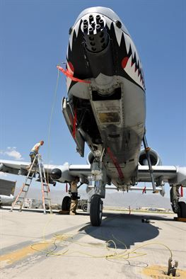Members of the 455th Expeditionary Aircraft Maintenance Squadron perform a post flight check on an A-10 Thunderbolt II on Bagram Airfield, Afghanistan, May 8, 2013. The aircraft receive inspections before takeoff and after landing to ensure the safety of the aircraft and pilot. (U.S. Air Force photo/Senior Airman Chris Willis)