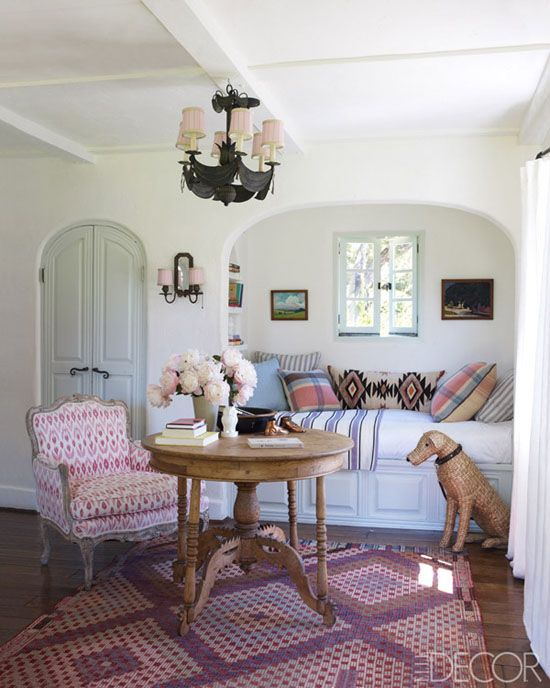 Reese Witherspoon Ojai home, pink girls room, patterns, pillows, ikat wingback chair, kilim rug, window seat bed, Elle Decor
