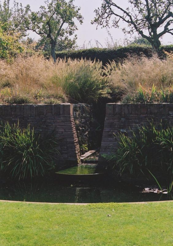 Knebworth Garden - Grasses linking existing orchard with arable land beyond; with Ian Kitson Landscape Architects