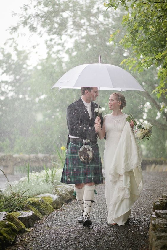 This bride and groom didn't let rain dampen their spirits! Charming rustic barn wedding in Ireland.: