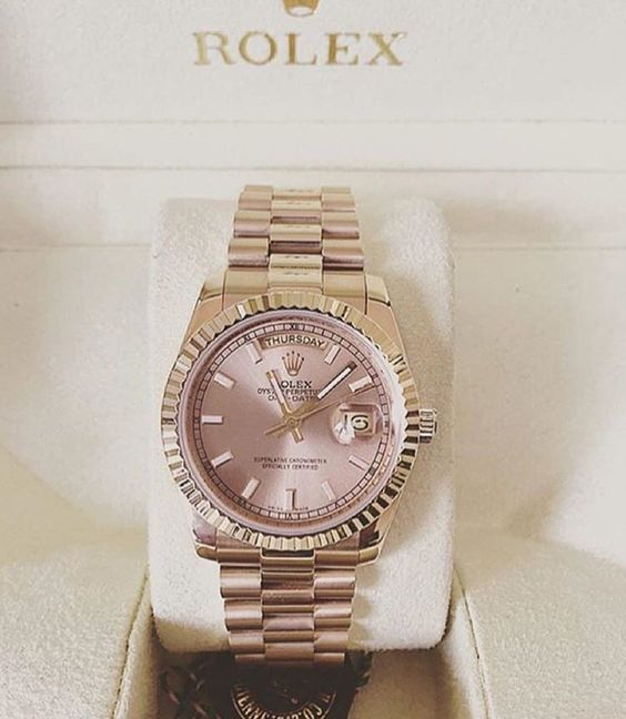 Dusty rose and gold Rolex for women http://www.thesterlingsilver.com/product/dreyfuss-co-ladies-seafarer-watch-dlb00052-01/