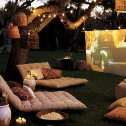 A beautiful and comfy outdoor movie set up! Photo via Pottery Barn