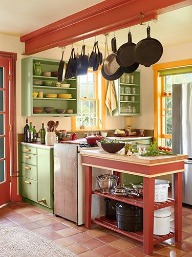 We can't get enough of this colorful kitchen! The walls are painted Golden Straw and the cabinets are painted Sherwood Green, both by Benjamin Moore.: