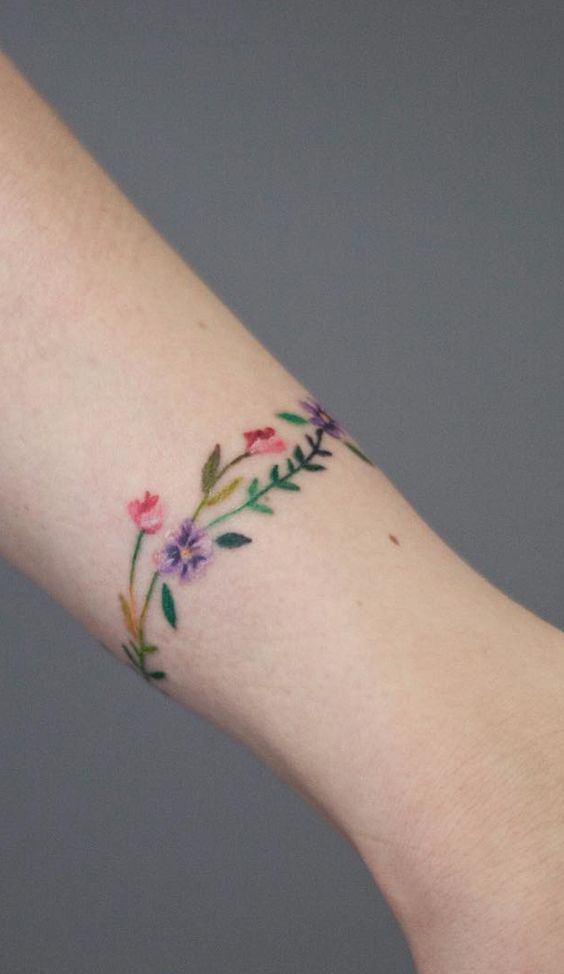 Flower Band Colored Tattoo On The Wrist Www Otziapp Com Wrist Bracelet Tattoo Wrist Tattoos Classy Tattoos