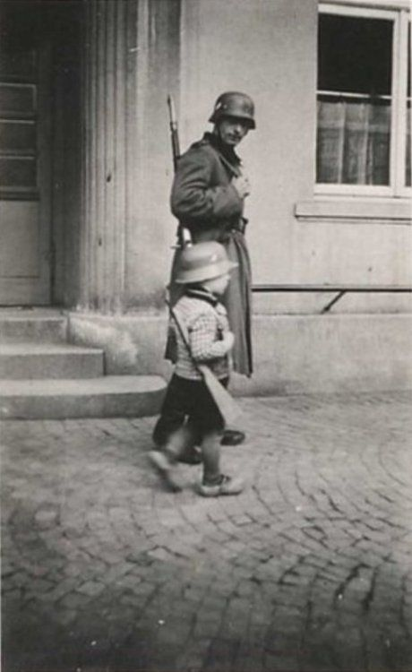 A German Soldier And A Child