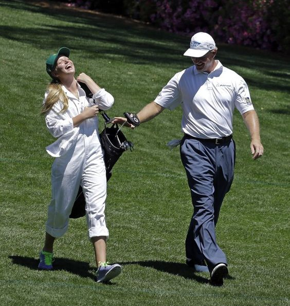 Ernie just mentioned to his caddy there should be 14 clubs in the bag.  The caddy's his daughter Samantha