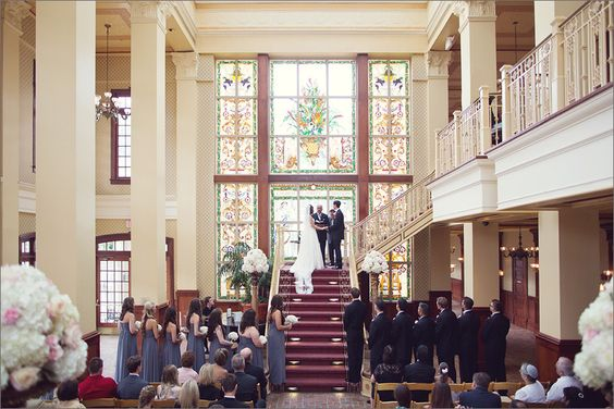 Ceremony in the atrium at The Ballroom at Church Street in Orlando, Fl. Photo by Vitalic Photos.