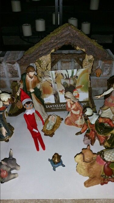 Chippy visiting baby Jesus. He left a book for my son that helps to tie santa to the true meaning of Christmas.