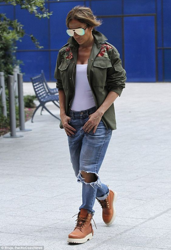 She's got good jeans!Looking defiantly street smart, the chart-topper displayed her assets in a pair of ripped Gucci jeans, which offered just a hint of her toned legs