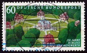german castle stamps: GERMANY - CIRCA 1987: a stamp printed in the Germany shows Clemenswerth Hunting Castle Built in Sogel by Clemens August of Bavaria, 250th Anniversary, circa 1987 Editorial