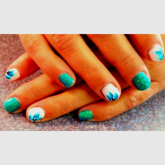 Mix CND Shellac with some Martha Stewart Glitter and some swishes of an art brush and you got yourself some Turquoise Paradise!  Nails By Jeannie  Nail Station Glen Burnie MD