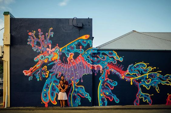 Jade and Liz at @christie.wright 's post Napier @seawalls_ Seawall I loved the festival and met lots of the artists so I felt pretty stoked when Liz and Jade wanted to do a mini mural tour for their engagement session  @mrcinzah @organic.ash @pangeaseed #paintforapurpose #seawalls #seahorse #vsco #vscofilm @napiernow #napier #vscofilm #kodak #sunset #love #hawkesbayphotographer #lookslikefilm #followme #like4like #instagood #engaged