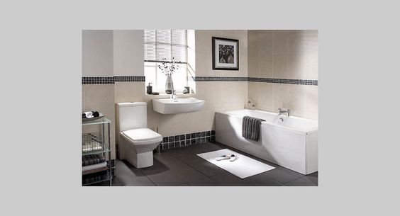 Grey Tiles and Square Toilet....