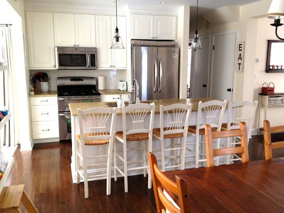 WhisperWood Cottage: 20 White Cottage Kitchens: I like these chairs for island seating
