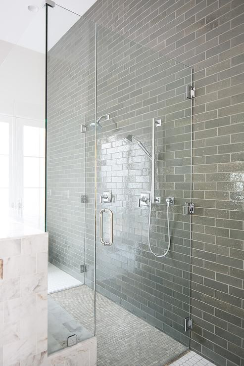 Gray Staggered Bathroom Wall Tiles Continue Into A Seamless Glass Shower Fitted With Dual Glass Doors Ligh Bathroom Wall Tile Small Master Bathroom Shower Wall