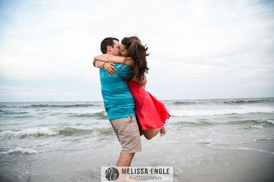 engagement photography, beach engagement photography, beach kiss, beach embrace, ocean engagement photography
