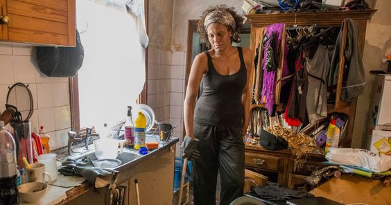 This image of a woman trying to keep her hellish, flea-infested flat clean echoes Nick Hedges' photographs of inner city housing from almost 50 years ago