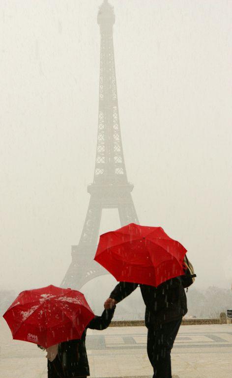 "Saatchi Art Artist: Owen Franken; Color Photography ""Red Umbrellas at the Eiffel Tower during a hailstorm"""