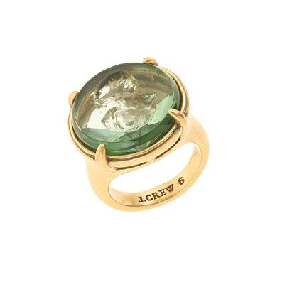 The Victorians had a few things going for them: Darwin, Dickens, even doilies, under the right circumstances. But our favorite throwback is easily the romantic (and highly personal) jewelry. Our cameo ring harkens back to Queen Vicky's times with a woman's profile pressed into green glass. Pair it with a pretty gold band (or two) for a modern feel. <ul><li>Brass, glass.</li><li>Light gold ox plating.</li><li>Import.</li></ul>