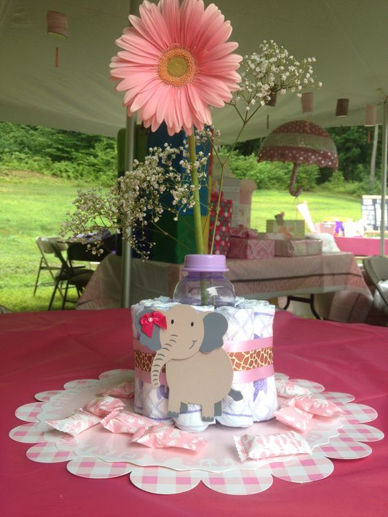 Elephant diaper cake around baby bottle with flowers