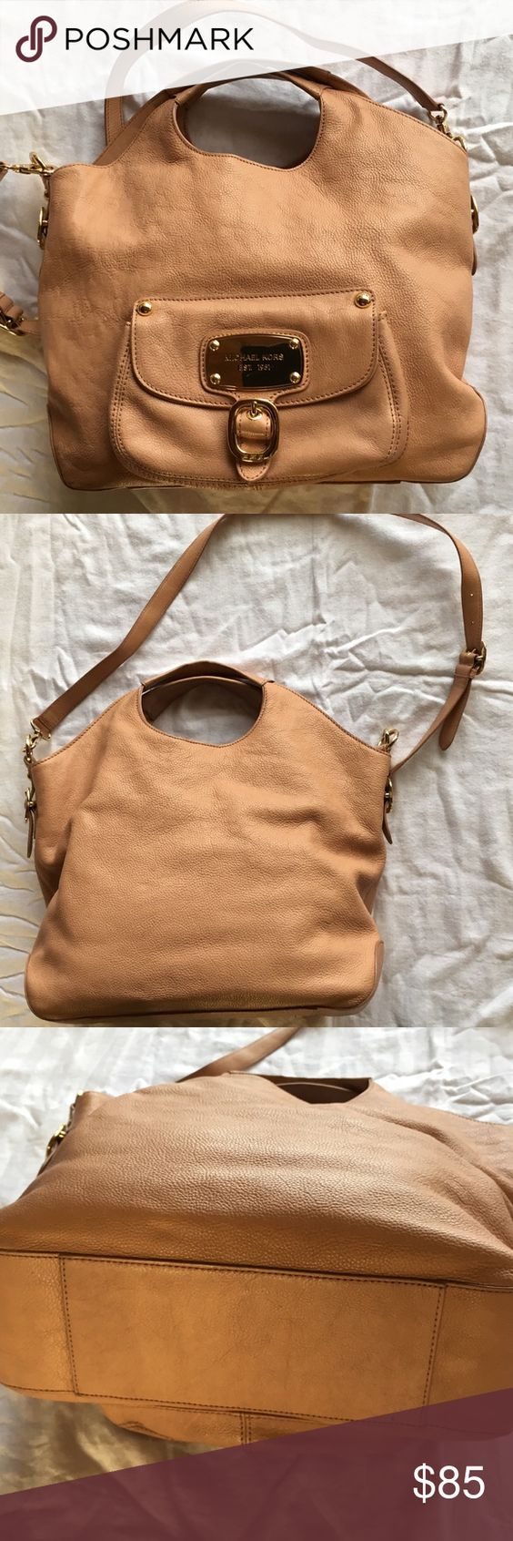 Authentic Michael Kors large leather bag Like new. Two large open sections and one zipped section inside. Cloth lined   Beige leather. Handles and a strap with gold-colored hardware Michael Kors Bags