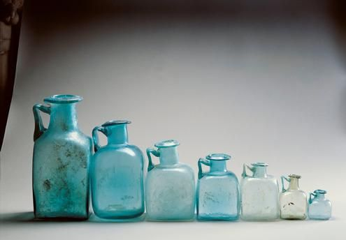 Roman civilization, 1st century A.D. Seven square-based light blue or colourless glass bottles used as measures of capacity (each bottle is twice the size of the next one). From Pompei. Naples, Museo Archeologico Nazionale (Archaeological Museum)