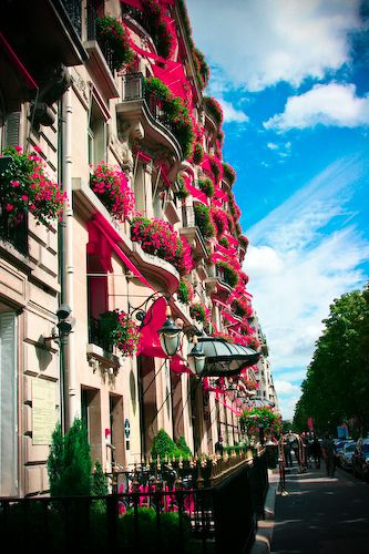 Vibrant Flower Balconies add to the Iconic Parisian Architecture - Plaza Athenee Hotel, Paris, France.