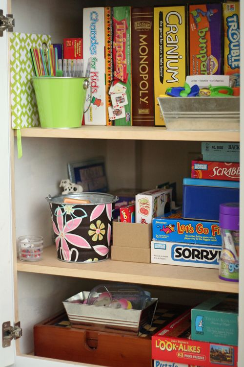 """Board Game storage - love the idea to """"shelve"""" them like books - spines out"""