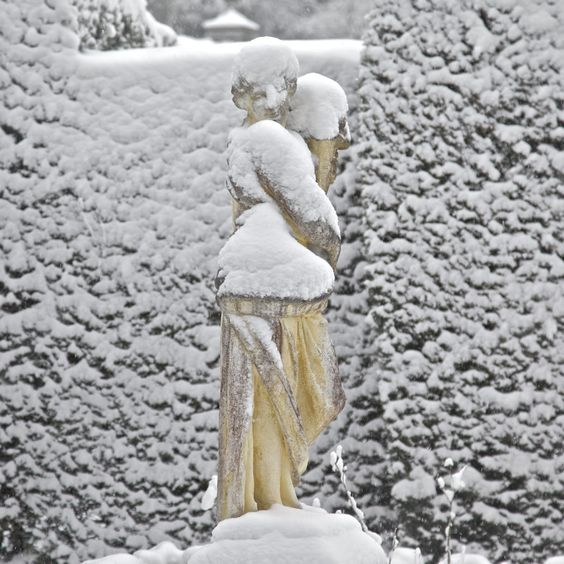 Snow covered Garden Statue