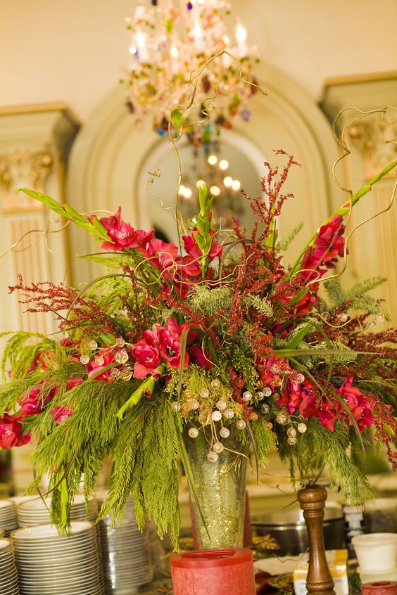 """Happy centerpeice in clients main formal kitchen where we had placed the catering team for serving guests delictable delights in """"A Versaille Christmas in California""""."""