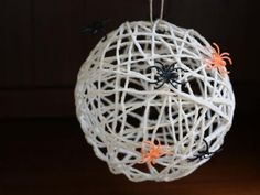 Why buy Halloween decorations when you can have your kids make really cool ones? This 3-D Yarn Spider Web is fun to make and will turn heads this Halloween!