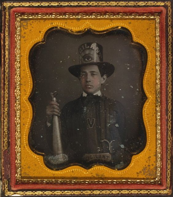Firefighter wearing a parade hat and holding speaker trumpet, Vigilant Fire Company, Baltimore, 1840-1860