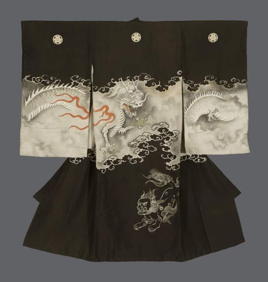 Boy's Christening Kimono. Meiji period (1868-1911). Japan.  The Kimono Gallery. An unusual fine plain silk antique miyamairi kimono featuring yuzen-dyed dragon and guardian dog motifs. The three-clawed dragon depicted on this kimono holds a tide-compelling jewel in it's right claw.