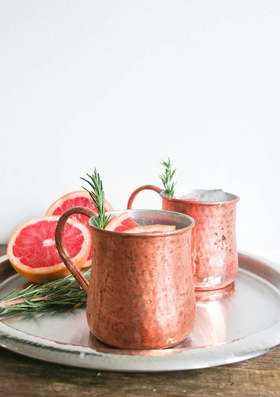 Grapefruit Rosemary Moscow Mule -  Gin, Rose Syrup (Recipe), Lemon Juice, Ruby Red Grapefruit Juice, Peychauds Bitters, Cardamom Pod.:
