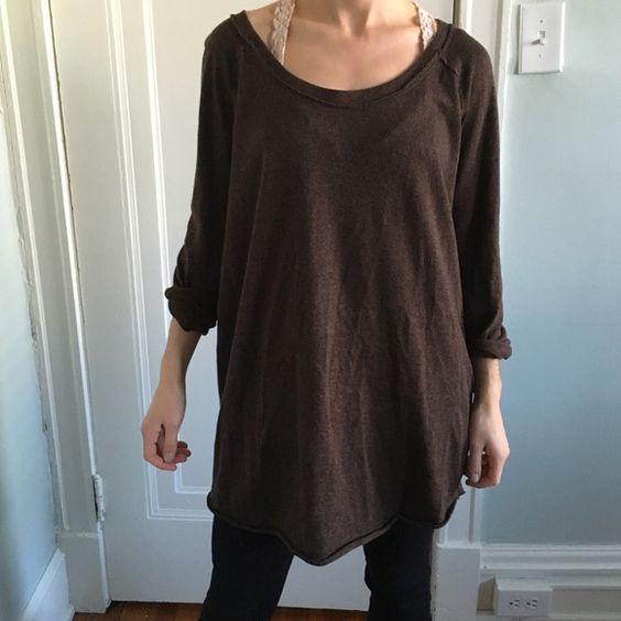 Free people tunic Brown free people slightly high low oversized tunic with cute back button up detailing. Worn once. Free People Tops Tees - Long Sleeve