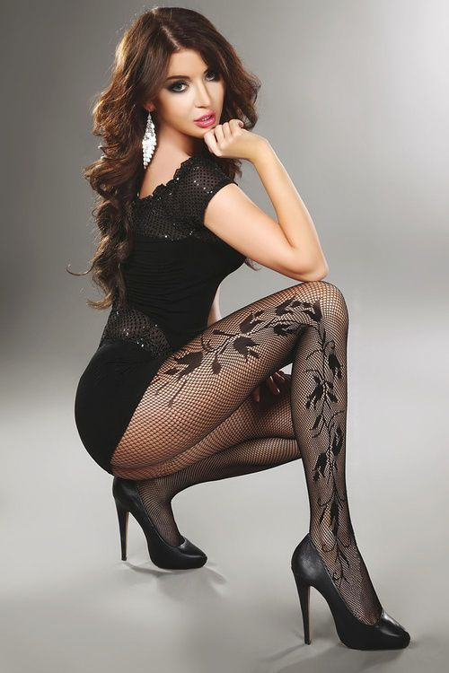 WOW! Super sexy brunette angel in short black dress, high heels and patterned fashion fishnet pantyhose.