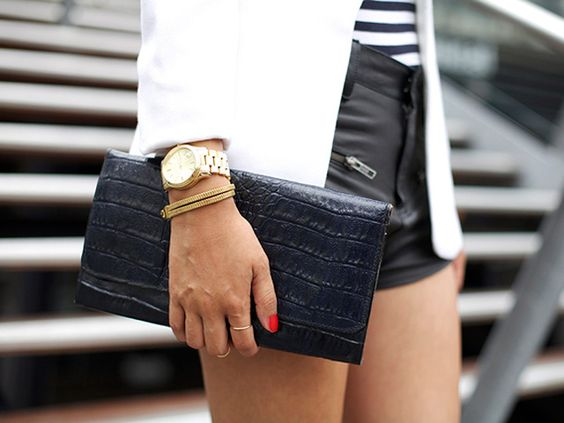 great clutch & watch.  love the bright nail polish w/ black & white outfit.