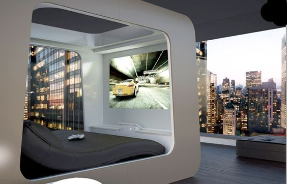 This futuristic bed includes custom lighting, an HD projector, remote-control blinds, and a built-in Xbox. Crazy.