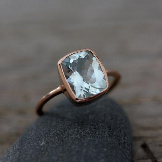 Aquamarine and recycled 14k rose gold ring, via Etsy.