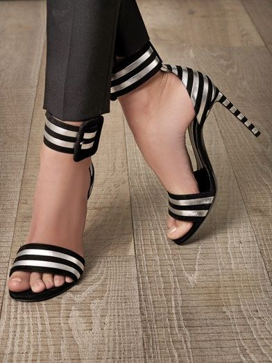 Saint Laurent, natch...... Love the shoes but they could have straighten out her toe!