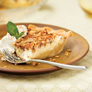 The nutty topping on this pecan cheesecake pie adds a nice crunch to the characteristic creaminess of this popular dessert.