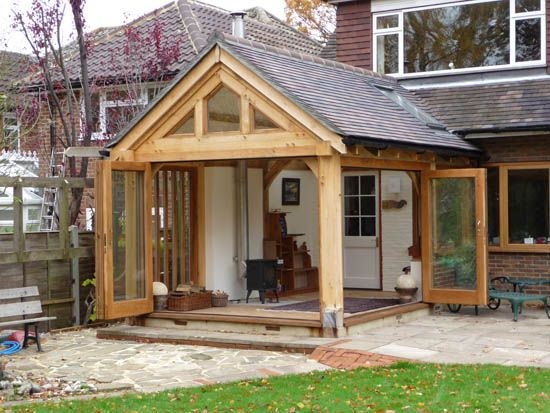 Oak frame garden room with bifold doors can 39 t get more for Oak framed garden room
