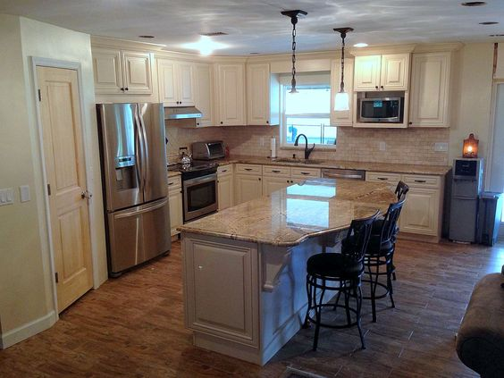 Cream cabinets with maple glaze, large island, farmhouse country kitchen