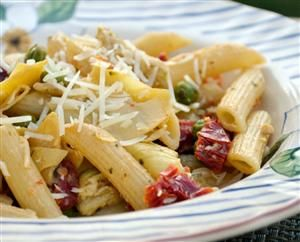 Creamy Penne with Artichokes, Sun Dried Tomatoes and Peas. Looks great for a spring meal. Mmm.
