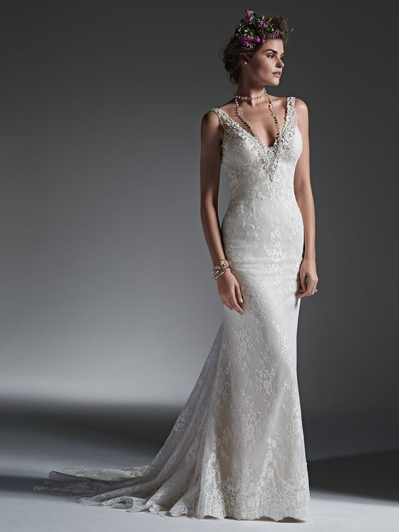 Sottero and Midgley - PERRI, Subtle and elegant, this lace sheath wedding dress features a dramatic V-neckline, encrusted with decadent pearls, Swarovski crystals, and glass beads, tracing the tank shoulder straps, and leading down a daring, open back. Finished with covered buttons over zipper closure.