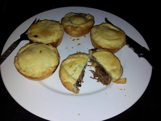 Mini Beef pies with sour dough pastry (250g flour, 125g sour cream, 200 butter). Filled with slow cooked beef in Guinness (4 onions, 3 garlic, 2 carrots, 500g beef, 1 can Guinness, 1L beef stock, thyme). Very nice